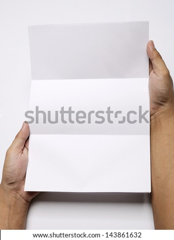 Male hand holding folded blank A4 copy space letter