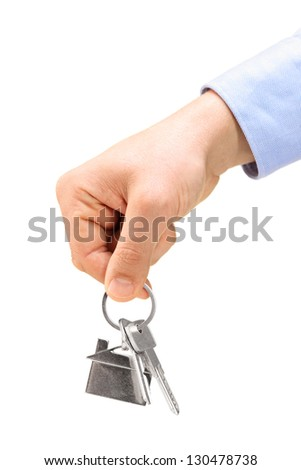 Male hand holding keys on a key ring, isolated on white background - stock photo