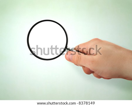 male hand holding magnifying glass,  the area of the lens is left blank for your content
