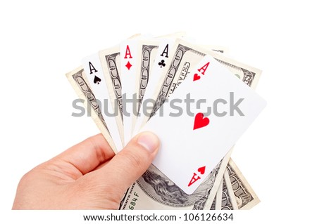Male hand holding poker of aces and hundred-dollar bills, on the white background