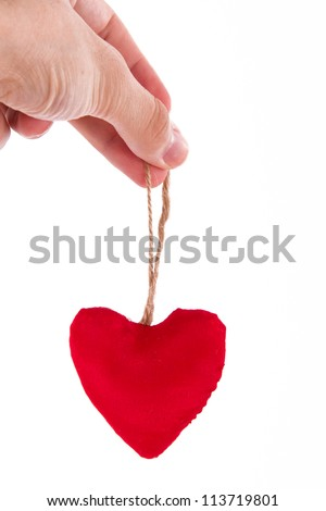 Male hand holding red heart, isolated on white background.
