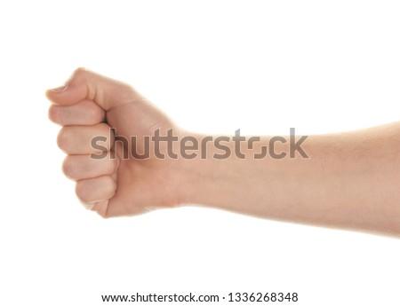 Male hand holding something on white background #1336268348