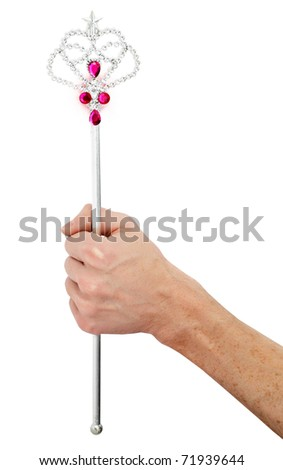Male hand holds magic wand - father gives gifts to children