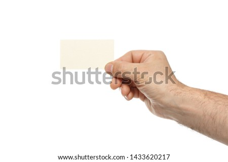 Male hand is holding a blank business card isolated on white background.
