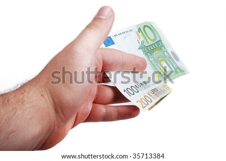 Male hand is holding euro between fingers