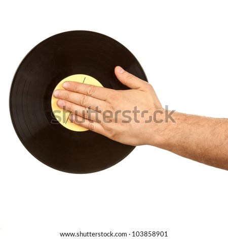 Male hand on vinyl record isolated on white