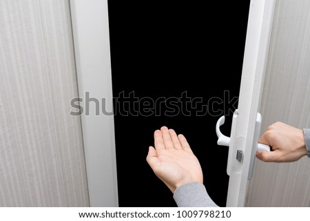 male hand opens the door, shows what's inside, white background with copy space