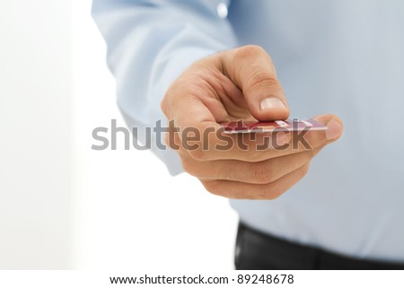 Male hand paying with the credit card