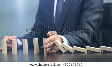 male hand placing wooden block on a tower. planing and strategy concept #522676762