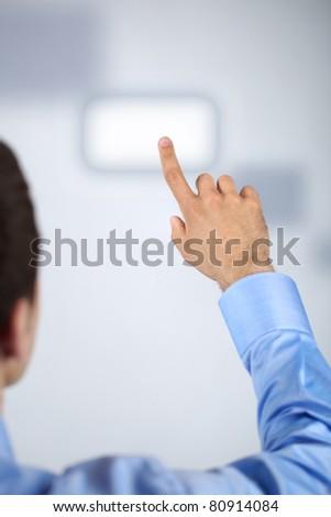 Male hand pressing virtual button