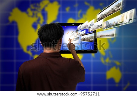 Male Hand push on Touch screen tablet PC as Media technology concept