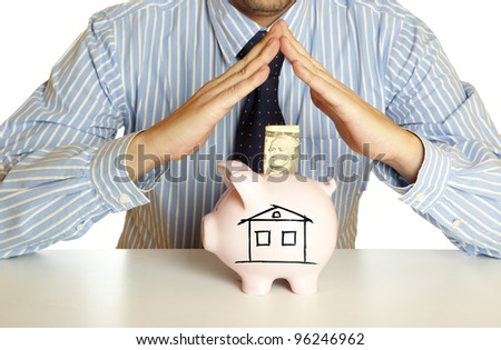 Male hand putting dollar into a piggy bank