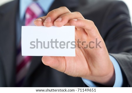 Male hand showing a business card
