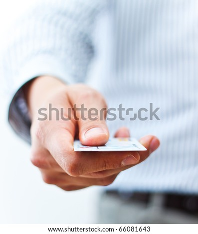 Male hand showing credit card