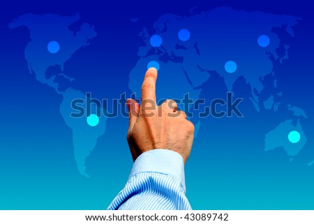 male hand touching a point on a world map, global choice concept