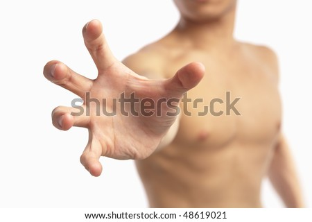 Male hand trying to reach out to camera, isolated and selective focus