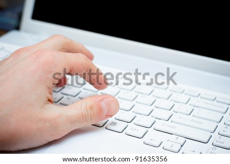 male hand typing on keyboard