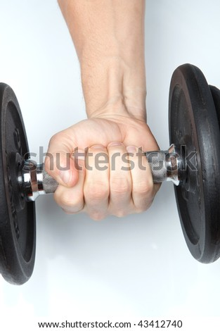 male hand with an exercising weight/dumbbell