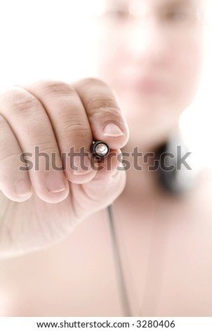 Male hand with cables  over white background, small DOF