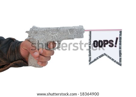 male hand with fire a shot newspaper pistol and flag on white background. oops fake