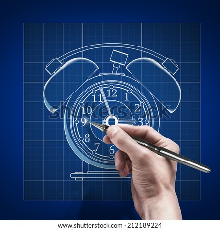 Royalty free male hand with pen blueprint engineer 212189245 male hand with pen blueprint engineer working on blue print concept old fashioned alarm malvernweather Gallery