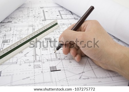 Male hand with pen in drawing