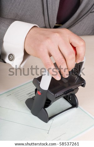Male hand with rubber stamp