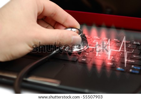 Male hand with stethoscope over black keyboard of laptop