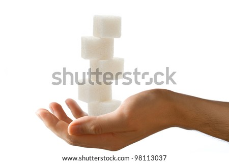 Male hand with sugar cubes