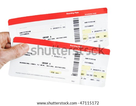 Male hand with two red and white boarding passes. Isolated and name and airline removed