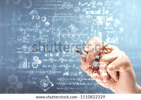 Male hand writing mathematical formulas on blurry background. Science and algebra concept. Double exposure