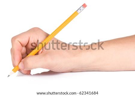 male hand writing yellow wood pencil