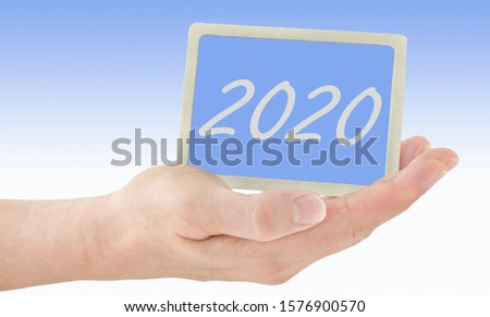Male hands and 2020 label background