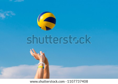 male hands catching valleyball ball Copy-space