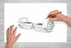 Male hands drawing a self-balancing board on white paper with a pencil in close view. Art and technologies. Creative design. Urban transportation.