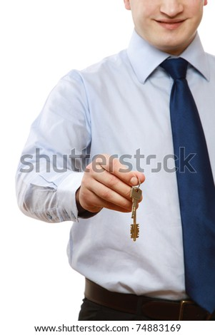 Male hands giving keys to a woman