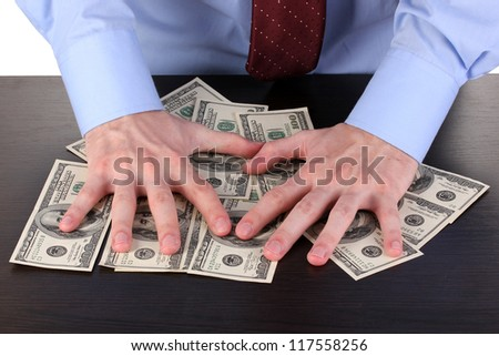 male hands hold dollars on a wooden table close-up