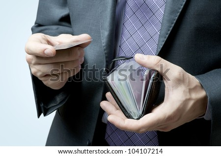 Male hands holding credit cards