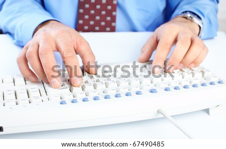 Male hands on a white keyboard