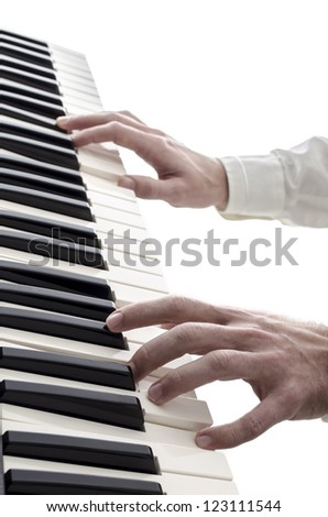 Male hands playing digital piano. Isolated over white background.