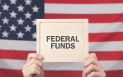 Male hands showing Federal Funds text.