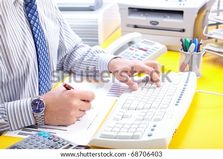 Male hands typing on a white keyboard