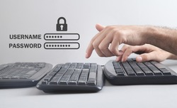 Male hands typing on computer keyboard. Username and Password with padlock