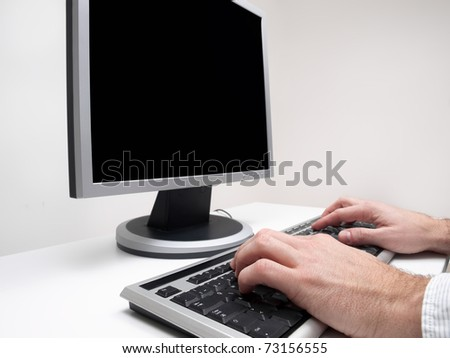 Male hands typing on the  computer keyboard with monitor black screen for copy space, for computing,internet,communication themes
