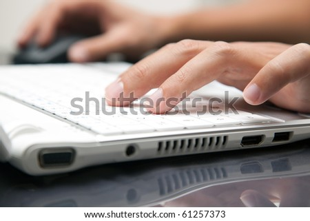 Male hands typing on the keyboard