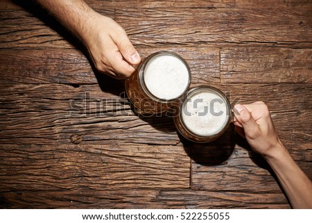 male hands with beer mug on an...