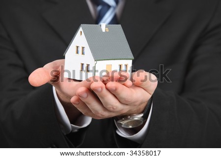 male hands with model of house