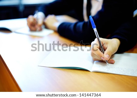 Male hands writing task while examination