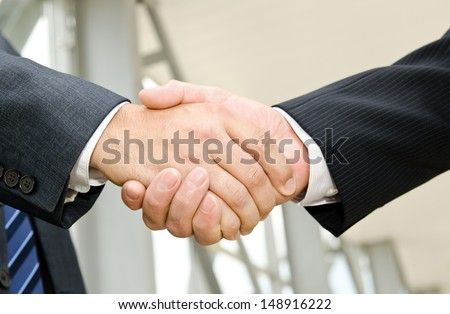 Male handshake on business background  - stock photo