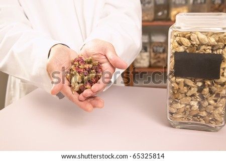 Male herbalist with Chinese medicinal herbs